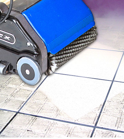 Cordless battery powered cleaner for cleaning bathroom tiles and floors